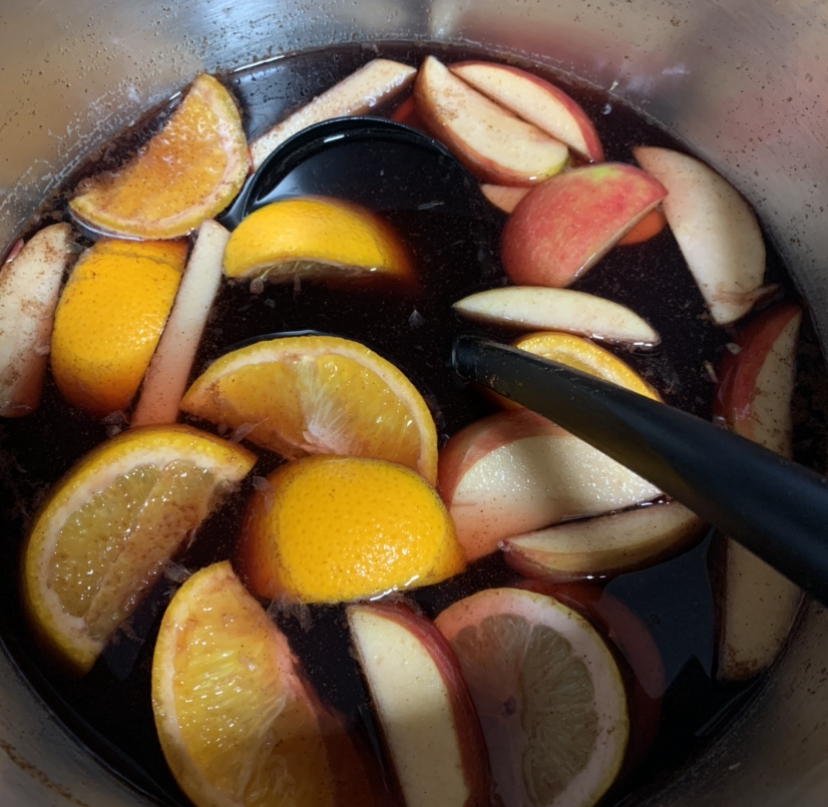 Sangria with key ingredients: brown sugar and cinnamon